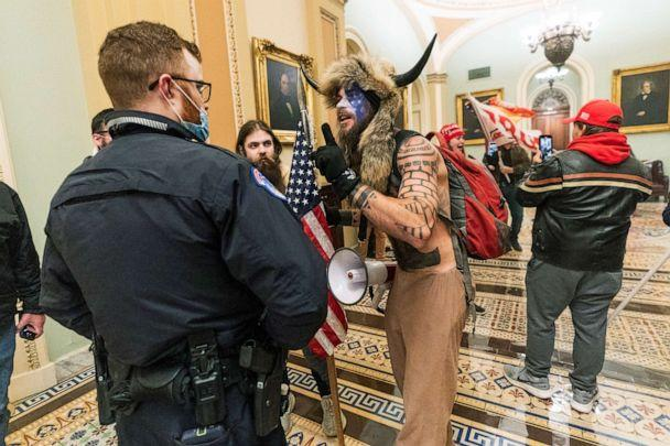PHOTO: Jacob Chansley and other supporters of President Donald Trump are confronted by U.S. Capitol Police officers outside the Senate Chamber inside the Capitol in Washington, Jan. 6, 2021. (Manuel Balce Ceneta/AP, FILE)