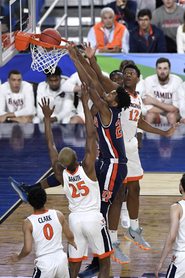 Anfernee McLemore #24 of the Auburn Tigers attempts to dunk the ball against Mamadi Diakite #25 and De'Andre Hunter #12 of the Virginia Cavaliers in the first half during the 2019 NCAA Final Four semifinal at U.S. Bank Stadium on April 6, 2019 in Minneapolis, Minnesota. (Photo by Hannah Foslien/Getty Images)