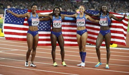 Athletics - World Athletics Championships – women's 4 x 100 meters relay final – London Stadium, London, Britain – August 12, 2017 – Aaliyah Brown, Allyson Felix, Morolake Akinosun and Tori Bowie of the U.S. celebrate winning the gold medal. REUTERS/Phil Noble