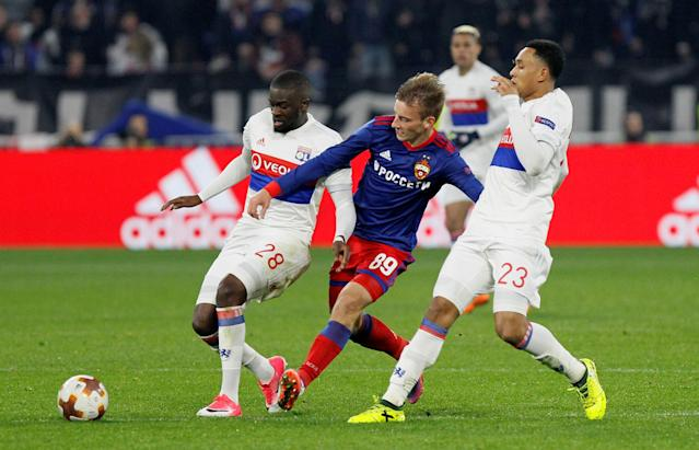 Soccer Football - Europa League Round of 16 Second Leg - Olympique Lyonnais vs CSKA Moscow - Groupama Stadium, Lyon, France - March 15, 2018 Lyon's Tanguy Ndombele and Kenny Tete in action with CSKA Moscow's Konstantin Kuchaev REUTERS/Emmanuel Foudrot