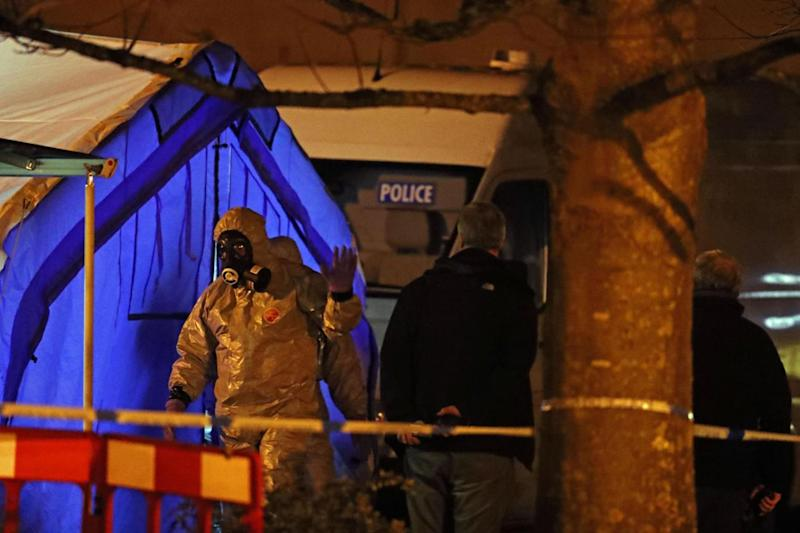 Investigators next to a police tent outside the Mill pub at the Maltings in Salisbury (PA)