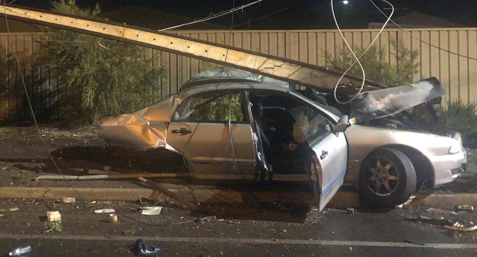 Power pole on top of a Mitsubishi Magna that crashed in Adelaide.
