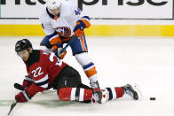 New Jersey Devils defenseman Ryan Murray (22) and New York Islanders center Jean-Gabriel Pageau (44) get tangled up during the second period of an NHL hockey game, Sunday, Jan. 24, 2021, in Newark, N.J. (AP Photo/Kathy Willens)