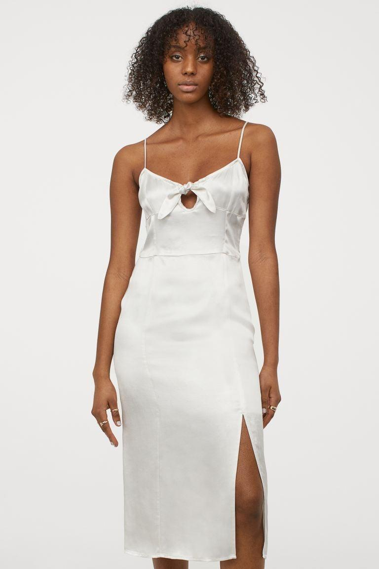 <p>We're into the little tie on this <span>H&amp;M Satin Slip-style Dress</span> ($35).</p>