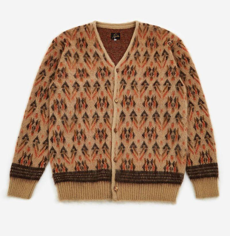 "<p>goodhoodstore.com</p><p><strong>$334.00</strong></p><p><a href=""https://us.goodhoodstore.com/products/needles-mohair-cardigan-triangle-beige-mens-aw20"" rel=""nofollow noopener"" target=""_blank"" data-ylk=""slk:Shop Now"" class=""link rapid-noclick-resp"">Shop Now</a></p>"
