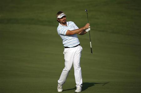 Dubuisson of France hits the ball on the 14th hole during the third round of the DP World Tour Championship in Dubai