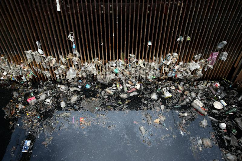 Garbage is seen in front of a floodgate at a canal in Bangkok, Thailand. (Photo: Athit Perawongmetha/Reuters)