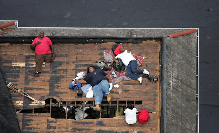 Residents wait on a rooftop to be rescued from the floodwaters of Hurricane Katrina in New Orleans, Sept. 1, 2005. (Photo: David J. Phillip/Pool/Reuters)