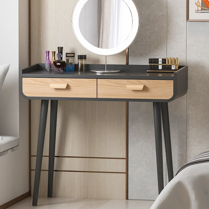 "<h3>George Oliver Kawakami Vanity</h3>Not only is this sleek vanity 50% off, but it can most definitely do double duty as both a place to get ready and a place to get your work done and store your unsightly office supplies. <br><br><br><br><br><strong>George Oliver</strong> Kawakami Vanity, $, available at <a href=""https://go.skimresources.com/?id=30283X879131&url=https%3A%2F%2Fwww.wayfair.com%2Ffurniture%2Fpdp%2Fgeorge-oliver-kawakami-vanity-w004260332.html"" rel=""nofollow noopener"" target=""_blank"" data-ylk=""slk:Wayfair"" class=""link rapid-noclick-resp"">Wayfair</a>"
