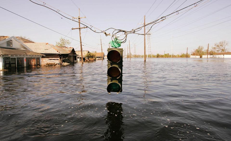 <p>A traffic light hangs over floodwaters from Hurricane Katrina September 7, 2005 in New Orleans, Louisiana. The mayor of New Orleans ordered out the remaining holdouts in New Orleans, and said force would be used if neccessary. (Photo by Chris Hondros/Getty Images) </p>