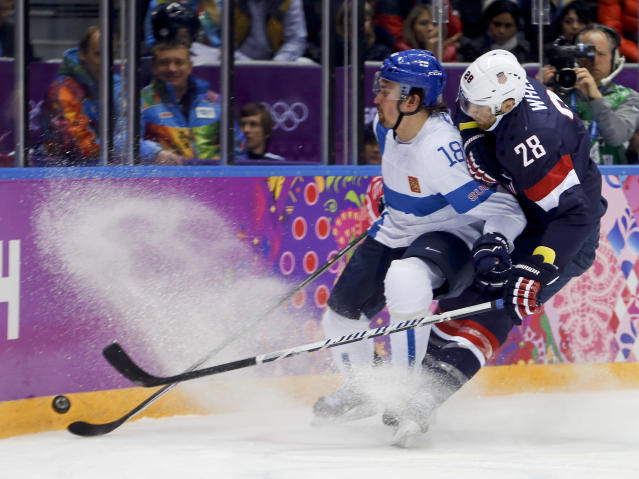 USA forward Blake Wheeler and Finland defenseman Sami Lepisto vie for the puck during the second period of the men's bronze medal ice hockey game at the 2014 Winter Olympics, Saturday, Feb. 22, 2014, in Sochi, Russia. (AP Photo/Petr David Josek)