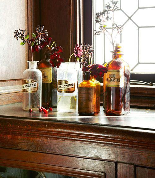 "<p>Haunted pharmacy theme? Fun! Vintage apothecary bottles serve double-duty as vases for dried blooms. See more at <a href=""http://www.goodhousekeeping.com/holidays/halloween-ideas/g421/halloween-decorating-ideas-1007/"" rel=""nofollow noopener"" target=""_blank"" data-ylk=""slk:Good Housekeeping"" class=""link rapid-noclick-resp"">Good Housekeeping</a>.</p><p><a class=""link rapid-noclick-resp"" href=""https://go.redirectingat.com?id=74968X1596630&url=https%3A%2F%2Fwww.etsy.com%2Flisting%2F681401679%2Falcohol-methylicus-vintage-apothecary&sref=https%3A%2F%2Fwww.housebeautiful.com%2Fentertaining%2Fholidays-celebrations%2Fg2554%2Fhalloween-decorations%2F"" rel=""nofollow noopener"" target=""_blank"" data-ylk=""slk:BUY NOW"">BUY NOW</a> <strong><em>Vintage Pharmacy Bottle, $72</em></strong></p>"