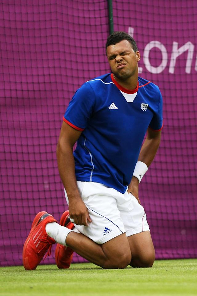 Jo-Wilfried Tsonga of France grimaces after taking a fall during the Men's Singles Tennis match against Thomaz Bellucci of Brazil on Day 2 of the London 2012 Olympic Games at the All England Lawn Tennis and Croquet Club in Wimbledon on July 29, 2012 in London, England. (Photo by Clive Brunskill/Getty Images)