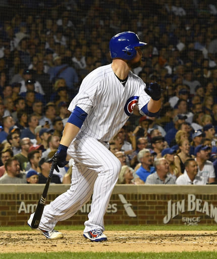 Chicago Cubs' Jon Lester watches his two RBI-single during the third inning of a baseball game against the New York Mets on Monday, Aug. 27, 2018, in Chicago. (AP Photo/Matt Marton)