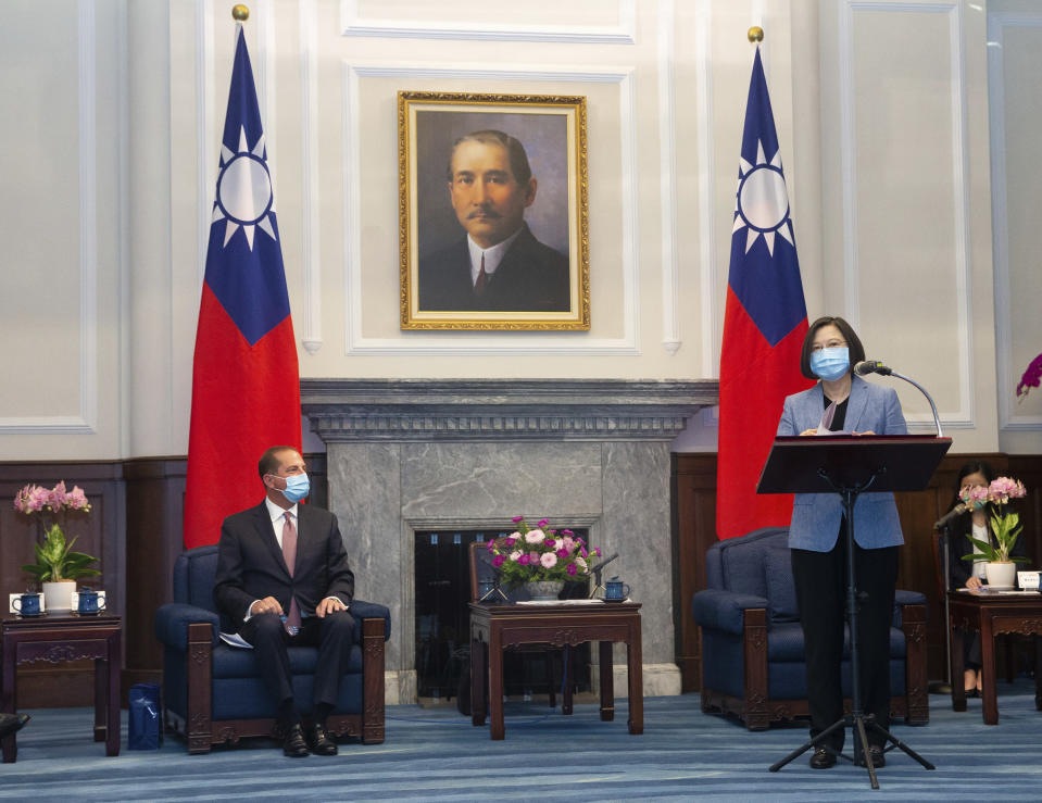 U.S. Health and Human Services Secretary Alex Azar, left, listens as Taiwan's President Tsai Ing-wen speaks during a meeting in Taipei, Taiwan Monday, Aug. 10, 2020. Azar met with Tsai on Monday during the highest-level visit by an American Cabinet official since the break in formal diplomatic ties between Washington and Taipei in 1979. (Pool Photo via AP Photo)