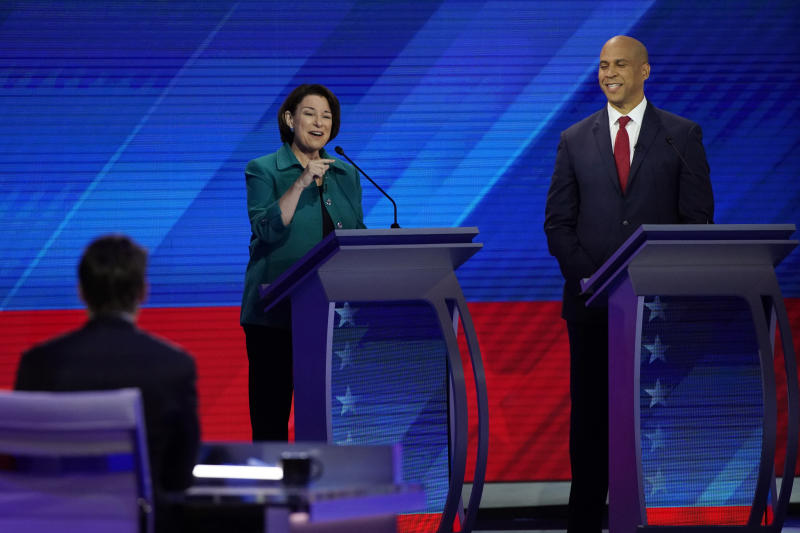 Sen. Amy Klobuchar, D-Minn., left, speaks as Sen. Cory Booker, D-N.J., right, listens Thursday, Sept. 12, 2019, during a Democratic presidential primary debate hosted by ABC at Texas Southern University in Houston. (AP Photo/David J. Phillip)