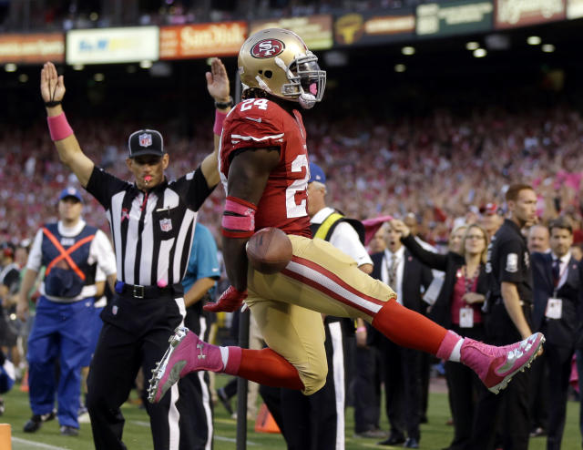 San Francisco 49ers running back Anthony Dixon leaps across the goal line after scoring a touchdown in the first half of an NFL football game against the Houston Texans in San Francisco, Sunday, Oct. 6, 2013. (AP Photo/Marcio Jose Sanchez)