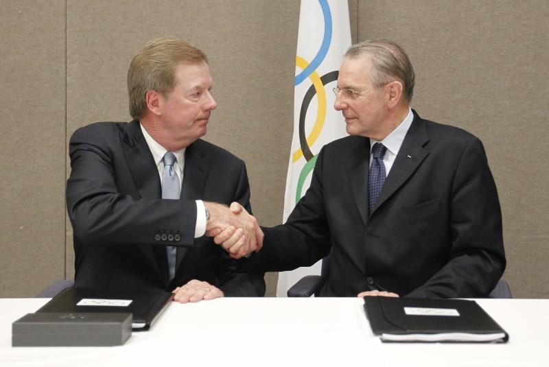 FILE - In this May 24, 2012 file photo, United States Olympic Committee chairman Larry Probst, left, and Olympic Committee President Jacques Rogge shake hands after signing an agreement between the IOC and the USOC at the SportAccord conference in Quebec City. The head of the U.S. Olympic Committee has been nominated for membership of the IOC, a big boost for U.S. efforts to expand its influence on the international Olympic stage. (AP Photo/Mathieu Belanger, Pool, File)