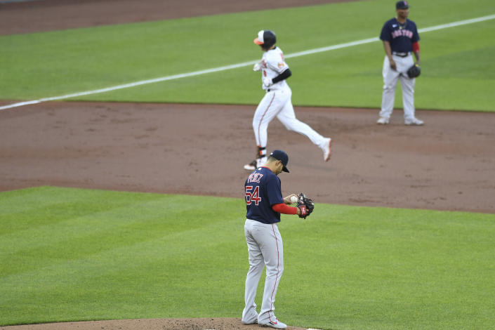 Boston Red Sox starting pitcher Martin Perez (54) reacts to first inning home run hit by Baltimore Orioles Ryan Mountcastle during a baseball game Monday, May 10, 2021, in Baltimore. (AP Photo/Terrance Williams)