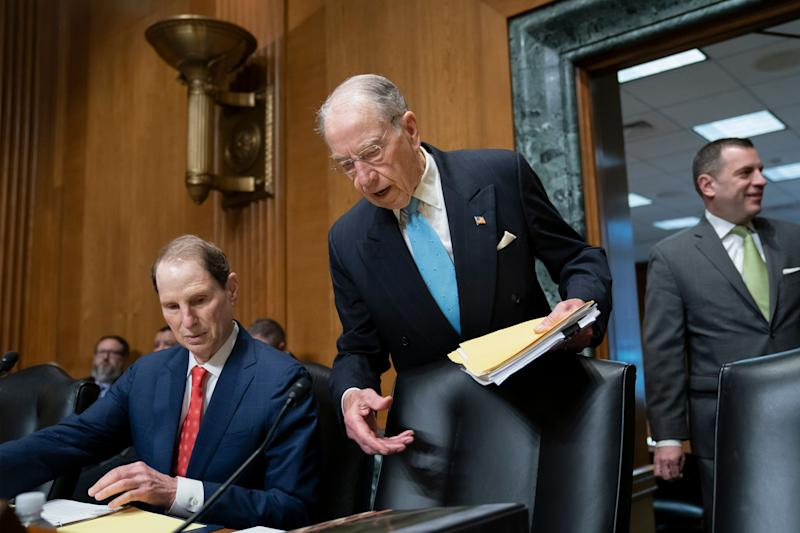 "Sen. Chuck Grassley, R-Iowa, chairman of the Senate Finance Committee, center, joined at left by Sen. Ron Wyden, D-Ore., the ranking member, arrives for the start of a hearing called ""Challenges in the Retirement System,"" on Capitol Hill in Washington, Tuesday, May 14, 2019. (AP Photo/J. Scott Applewhite)"