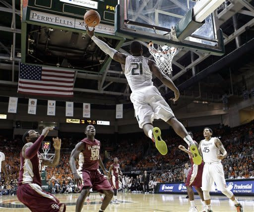 Miami's Erik Swoope (21) goes to the basket against Florida State during the first half of an NCAA college basketball game in Coral Gables, Fla., Sunday, Jan. 27, 2013. (AP Photo/Alan Diaz)