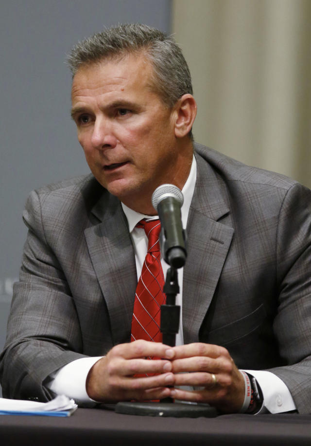 Ohio State football coach Urban Meyer answers questions during a news conference in Columbus, Ohio, Wednesday, Aug. 22, 2018. Ohio State suspended Meyer on Wednesday for three games for mishandling domestic violence accusations, punishing one of the sport's most prominent leaders for keeping an assistant on staff for several years after the coach's wife accused him of abuse. Athletic director Gene Smith was suspended from Aug. 31 through Sept. 16. (AP Photo/Paul Vernon)
