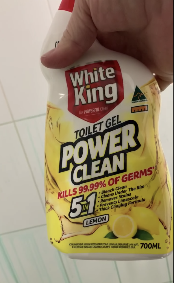 Hand holds White King Toilet Gel Power Clean worth $4.60
