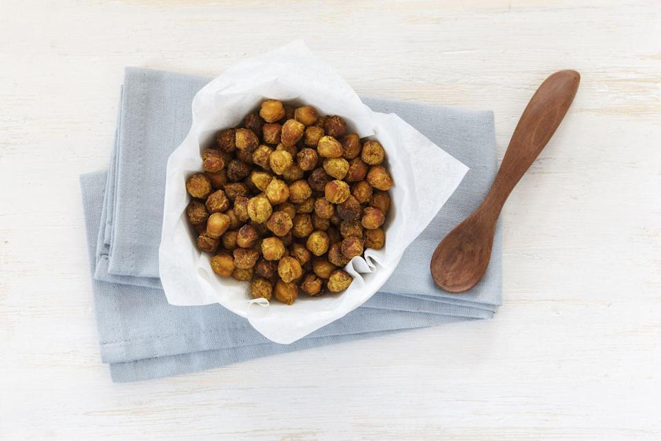 """<p>""""There are so many versatile ways to eat chickpeas - in the whole form by itself, as an addition to salads, or turned into hummus! Chickpeas can also help with satiety since it provides both protein and fiber. Protein and fiber work together to slow down digestion, which helps promote fullness,"""" Zhu notes. <strong>Check out our favorite variations of chickpea nuts developed by the Good Housekeeping Test Kitchen <a href=""""https://www.goodhousekeeping.com/food-recipes/a40814/chickpea-nuts-recipe/"""" rel=""""nofollow noopener"""" target=""""_blank"""" data-ylk=""""slk:here"""" class=""""link rapid-noclick-resp"""">here</a>.</strong></p>"""