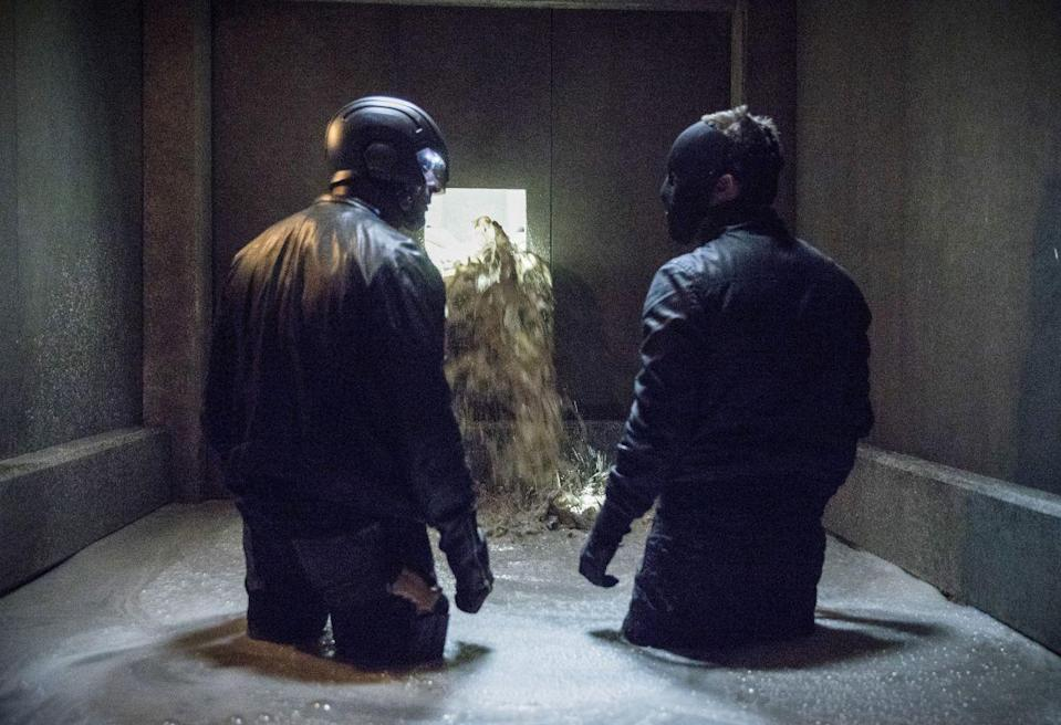 """<p>In one scene, Oliver and Diggle get trapped in wet cement. Juliana Harkavy told <em><a href=""""https://www.marieclaire.com/celebrity/a14375457/juliana-harkavy-arrow-interview/"""" rel=""""nofollow noopener"""" target=""""_blank"""" data-ylk=""""slk:Marie Claire"""" class=""""link rapid-noclick-resp"""">Marie Claire</a> </em>in an exclusive interview that they actually used thousands of gallons of oatmeal. """"After a couple of days it started to smell putrid, and we were all gagging and laughing the entire time we shot it,"""" Harkavy said. </p>"""