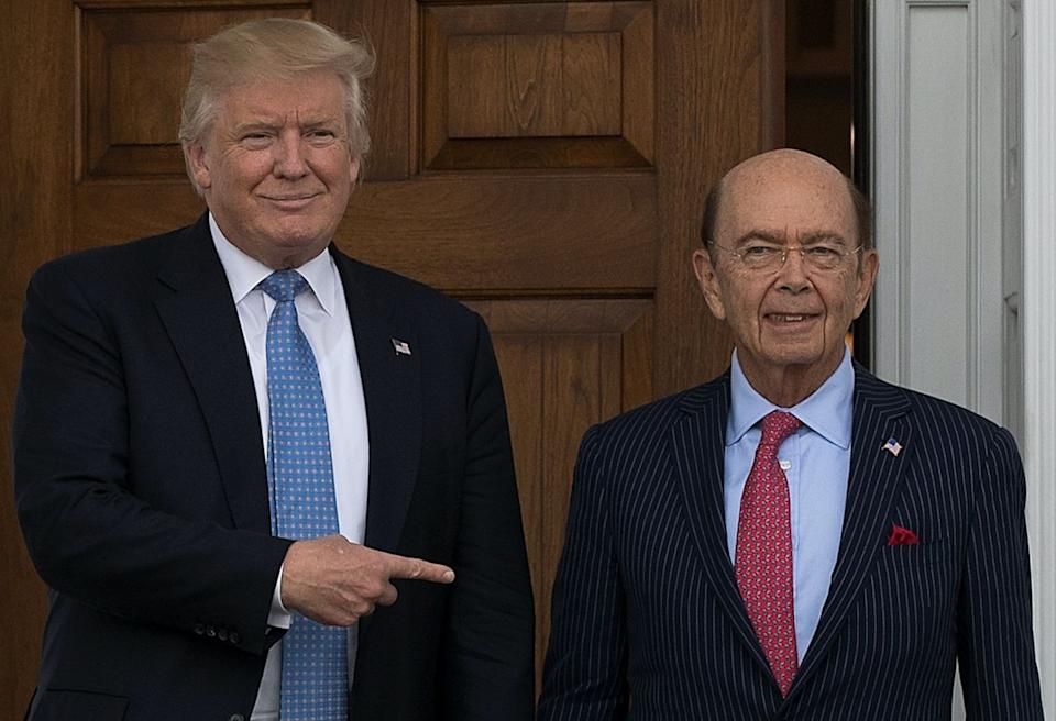 President-elect Donald Trump and investor Wilbur Ross pose for a photo following their meeting at Trump International Golf Club, November 20, 2016 in Bedminster Township, New Jersey. (Photo: Drew Angerer/Getty Images)