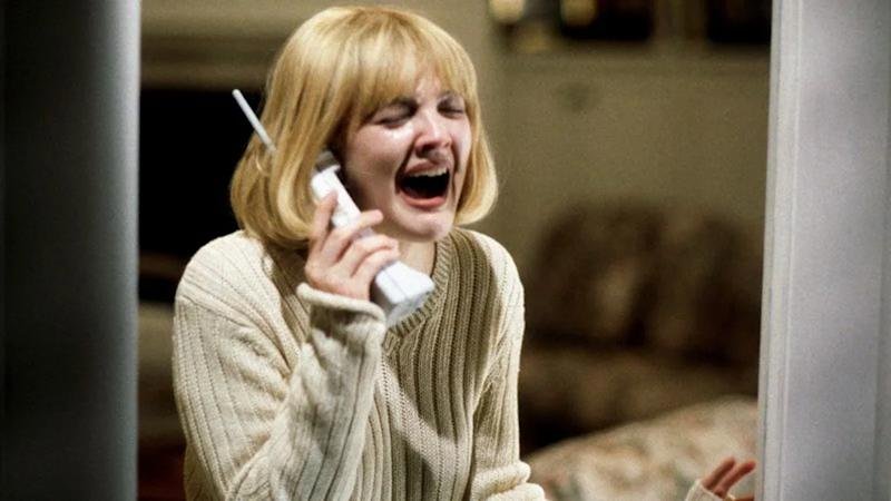 Drew Barrymore appears in the famous opening sequence of 'Scream' in 1996. (Credit: Dimension Films)