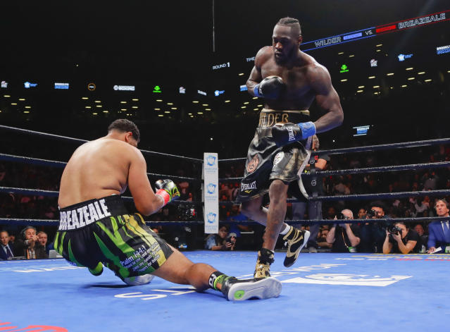 Deontay Wilder, left, knocks down Dominic Breazeale during the first round of the WBC heavyweight championship boxing match Saturday, May 18, 2019, in New York. Wilder won in the first round. (AP Photo/Frank Franklin II)
