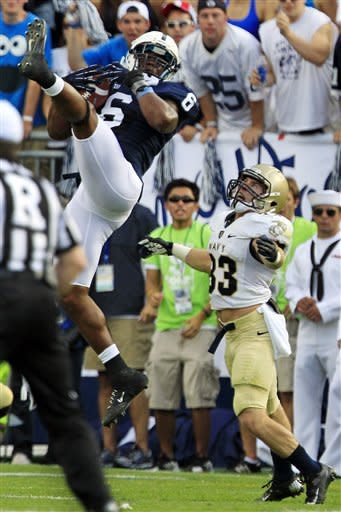 Penn State linebacker Gerald Hodges (6) intercepts a pass intended for Navy running back John Howell (33) during the second quarter of an NCAA college football game in State College, Pa., Saturday, Sept. 15, 2012. (AP Photo/Gene J. Puskar)