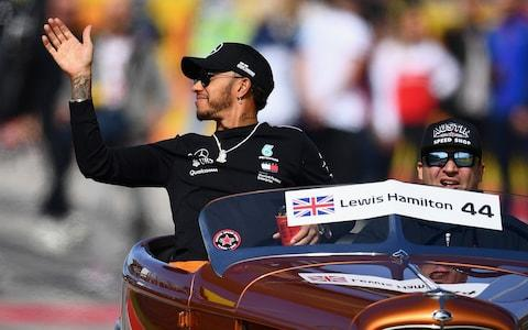 Lewis Hamilton of Great Britain and Mercedes GP waves to crowd on the drivers parade before the United States Formula One Grand Prix at Circuit of The Americas on October 21, 2018 in Austin, United States - Credit: getty images
