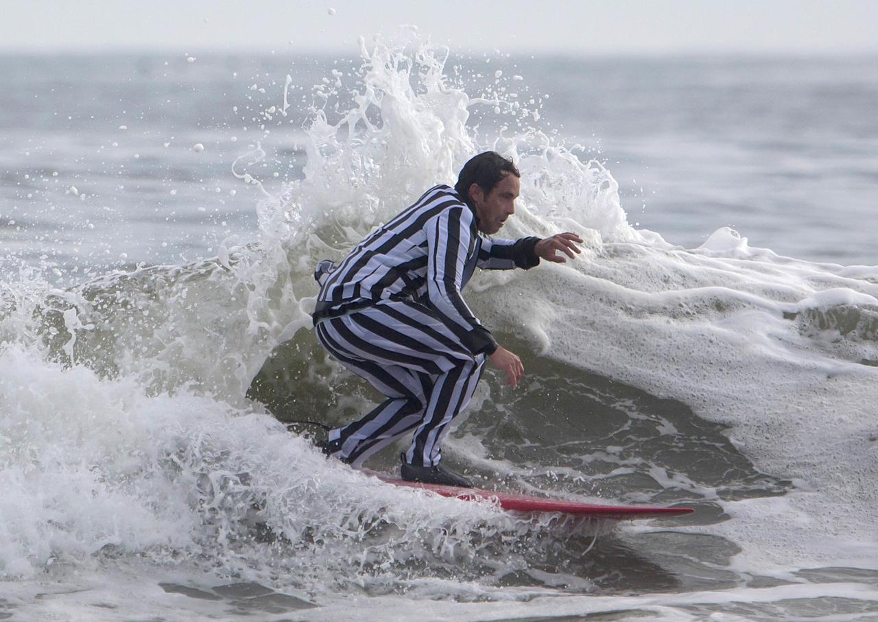 A participant surfs during the third annual Rockaway Halloween surf competition at Rockaway Beach in the Queens borough of New York November 2, 2013. REUTERS/Eric Thayer (UNITED STATES - Tags: SOCIETY)