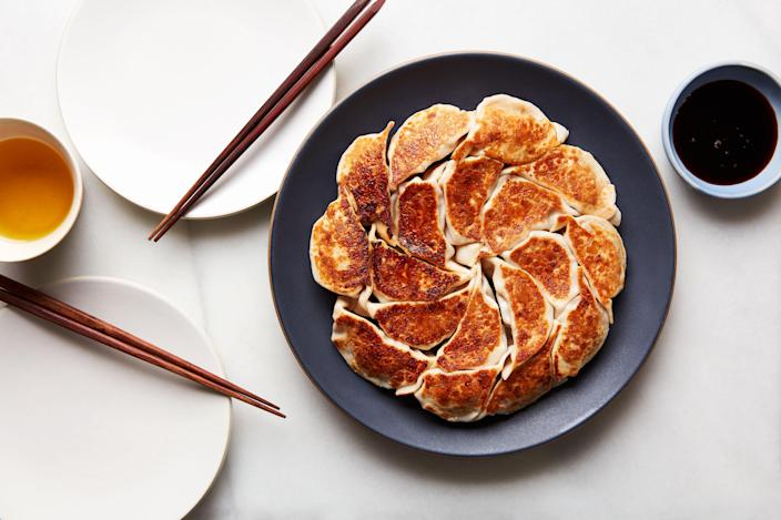"""The filling of these dumplings from <a href=""""https://www.epicurious.com/recipes-menus/sohui-kim-lunar-new-year-menu-korean-article?mbid=synd_yahoo_rss"""" rel=""""nofollow noopener"""" target=""""_blank"""" data-ylk=""""slk:chef Sohui Kim"""" class=""""link rapid-noclick-resp"""">chef Sohui Kim</a> is silky, moist, and rich, thanks to the inclusion of pork, chives, tofu, and hoisin sauce. <a href=""""https://www.epicurious.com/recipes/food/views/pork-and-chive-dumplings-sohui-kim?mbid=synd_yahoo_rss"""" rel=""""nofollow noopener"""" target=""""_blank"""" data-ylk=""""slk:See recipe."""" class=""""link rapid-noclick-resp"""">See recipe.</a>"""