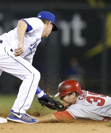 Los Angeles Angels' J.B. Shuck (39) is tagged out by Kansas City Royals second baseman Chris Getz, left, during the eighth inning of a baseball game at Kauffman Stadium in Kansas City, Mo., Friday, May 24, 2013. Shuck was caught stealing on the play. (AP Photo/Orlin Wagner)