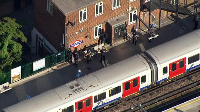 <p>In this aerial image made from video, police officers work at the Parsons Green Underground Station after an explosion in London Friday, Sept. 15, 2017. (Photo: Pool via AP) </p>