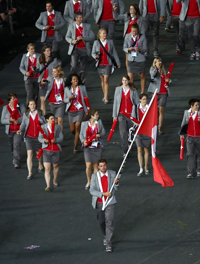 LONDON, ENGLAND - JULY 27: Stanislas Wawrinka of the Switzerland Olympic tennis team carries his country's flag during the Opening Ceremony of the London 2012 Olympic Games at the Olympic Stadium on July 27, 2012 in London, England. (Photo by Quinn Rooney/Getty Images)