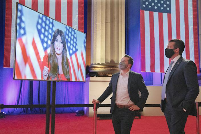 Donald Trump Jr. (right) watches his girlfriend, Kimberly Guilfoyle, a Trump campaign aide, as she records her address for Monday night's Republican National Convention program. (Photo: Chip Somodevilla via Getty Images)