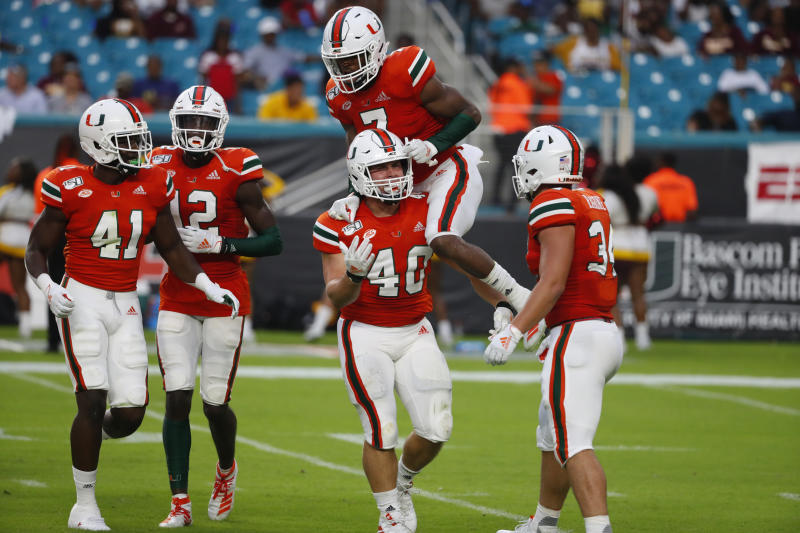 Miami cornerback Luis Gutierrez Jr. (40) is congratulated by cornerback Al Blades Jr. (7) after a tackle during the second half of an NCAA college football game against Bethune-Cookman, Saturday, Sept. 14, 2019, in Miami Gardens, Fla. (AP Photo/Wilfredo Lee)