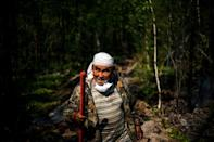 """""""I've lived my whole life in the taiga. I'm dependent on nature,"""" 65-year-old Ivan Fyodorov says as he helps fight a fire near his land. """"We have to protect it."""""""
