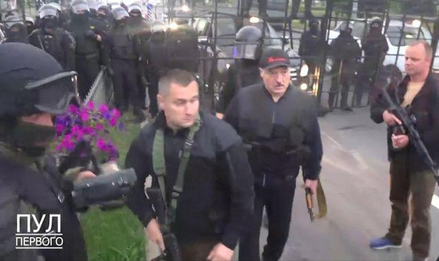 Belarus: Lukashenko brandishes rifle as army monitors 200,000 protesters
