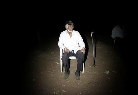 Ricardo Ruiz sits as he refuses to leave his home due to an evacuation in San Lorenzo Community, an area where wildfires have destroyed hectares of forest, near Robore