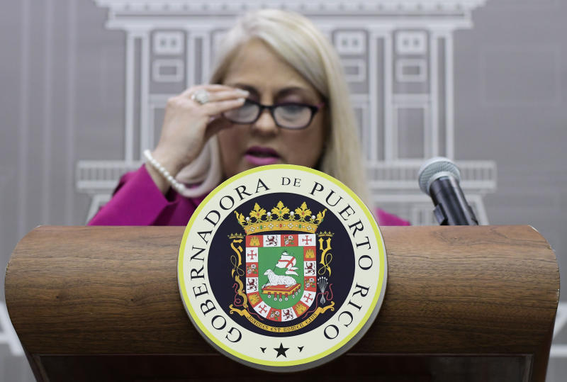 Puerto Rico's Governor Wanda Vazquez holds a press conference to announce new administrative appointments at La Fortaleza, the governor's official residence, in San Juan, Puerto Rico, Wednesday, Aug. 21, 2019. Vazquez appointed Senator Zoe Laboy as Chief of Staff, and the Executive Director of the Aqueduct and Sewer Authority Eli Diaz Atienza as representative on the Federal Board of Fiscal Control. (AP Photo/Carlos Giusti)