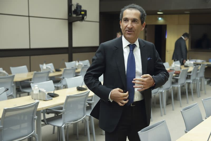 Patrick Drahi, Franco-Israeli businessman, Executive Chairman of cable and mobile telecoms company Altice and founder of Numericable arrives to attend a hearing at the French National Assembly in Pari