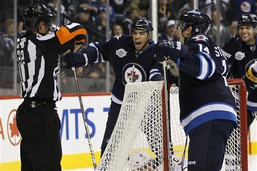 Winnipeg Jets' Evander Kane (9) and Tim Stapleton (14) dispute the referee's decision to disallow their goal against the Buffalo Sabres during second-period NHL hockey game action in Winnipeg, Manitoba, Thursday, Jan. 19, 2012. (AP Photo/The Canadian Press, John Woods)