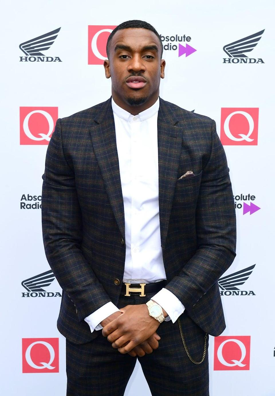 Bugzy Malone denies the charges (Ian West/PA) (PA Archive)
