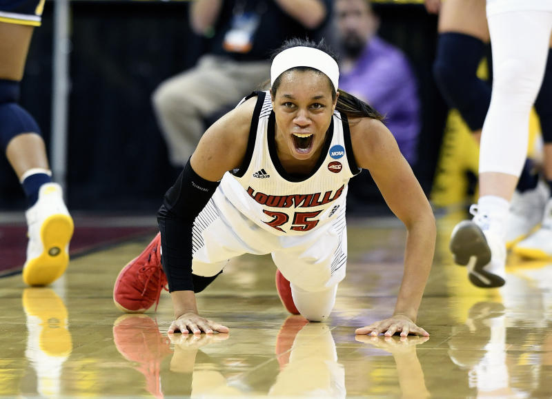 Louisville guard Asia Durr (25) shouts as she gets off the floor after being fouled during the first half of a second-round game in the NCAA women's college basketball tournament in Louisville, Ky., Sunday, March 24, 2019. (AP Photo/Timothy D. Easley)