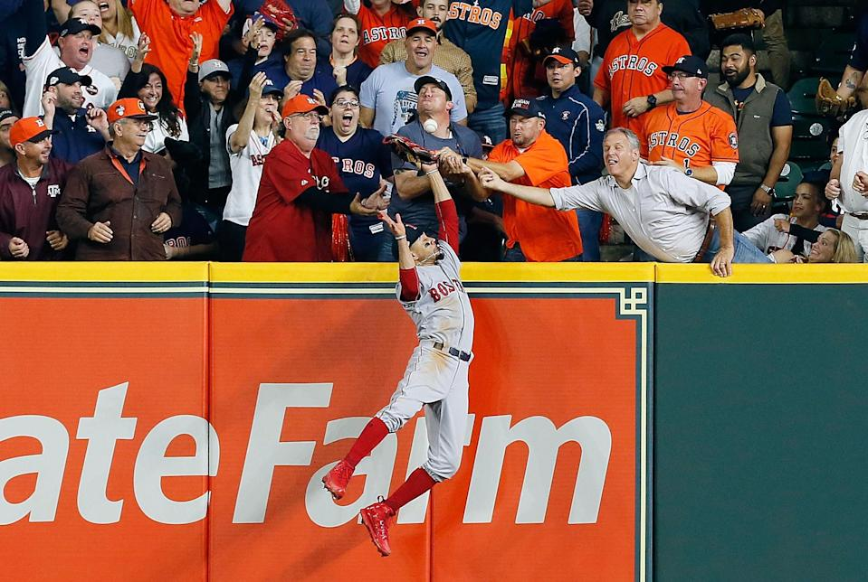 Jose Altuve was ruled out on fan interference when Mookie Betts reached over the wall to make a play on his ball. (Getty)